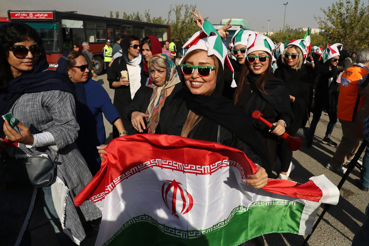 Government spokesman Ali Rabiei said he viewed the presence of women at the stadium as a positive step, according to the official IRNA news agency. [Vahid Salemi/AP Photo]