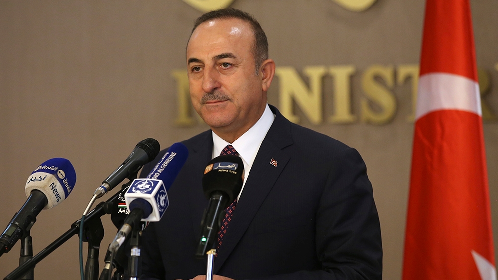 Turkey's Foreign Minister Mevlut Cavusoglu speaks to the media during a joint news conference with Algeria's Foreign Minister Sabri Boukadoum, in Algiers, Algeria, Wednesday, Oct. 9, 2019. Cavusoglu s