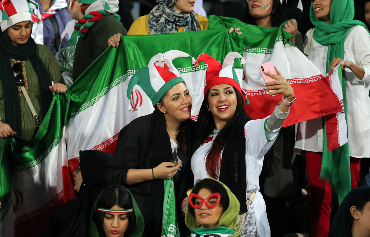Iranian women cheer during the FIFIA World Cup qualification match between Iran and Cambodia, at the Azadi stadium in Tehran, Iran, 10 October 2019. Media reported that thousands of Iranian women are