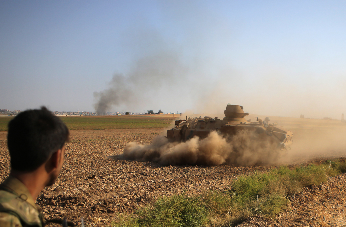 Fighting has engulfed the border area in northeast Syria since Turkey launched an offensive on October 9 to push back the Kurdish-led Syrian Democratic Forces (SDF). [Bakr AlKasem/AFP]
