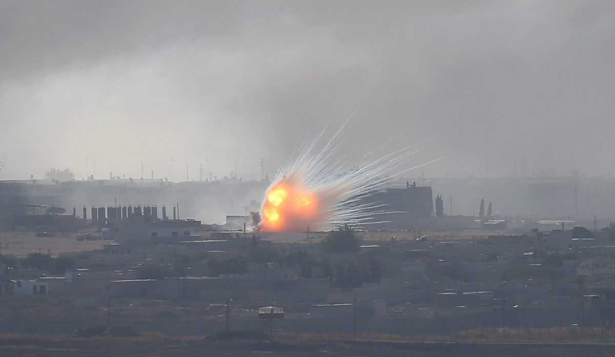 An explosion over the Syrian town of Ras al-Ain as seen from the Turkish border town of Ceylanpinar, Sanliurfa province. Turkey's military says it had taken control of the Syrian town. [Stoyan Nenov/Reuters]