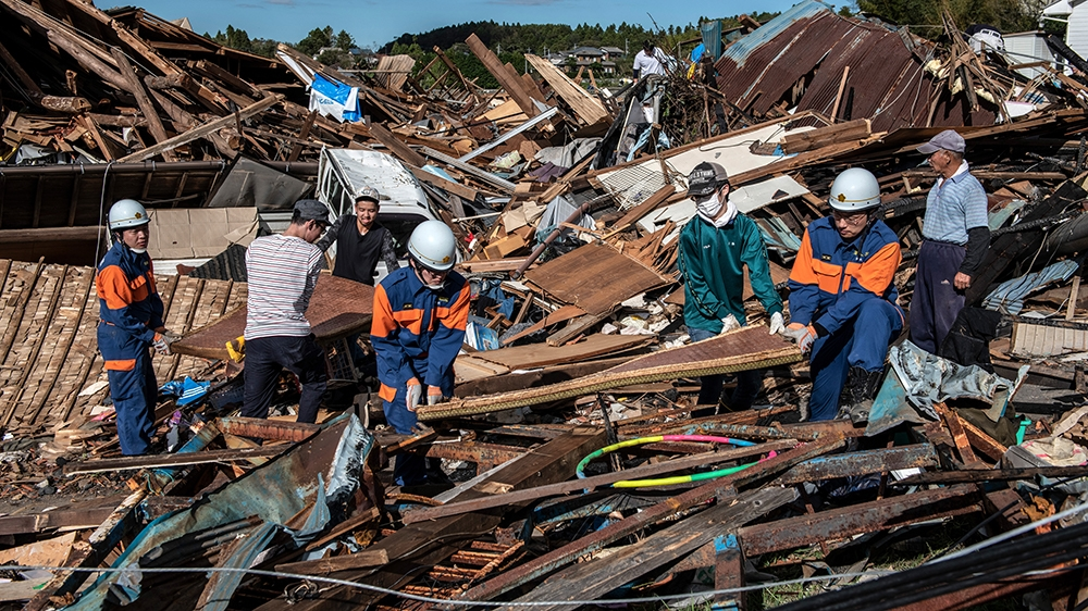 Search and rescue crews salvage belongings from the debris of buildings destroyed by a tornado shortly before the arrival of Typhoon Hagibis, on October 13, 2019 in Chiba, Japan. At least five people