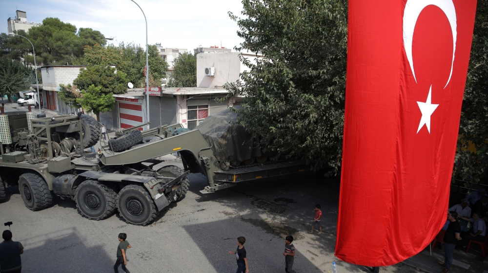Turkish military equipment is transported on a street in the Turkish border town of Akcakale in Sanliurfa province, Turkey, October 14, 2019