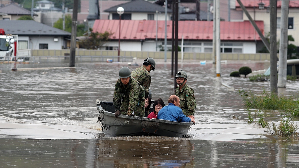Residents are rescued by Self-Defense Forces in Marumori, Miyagi prefecture, Japan, 14 October 2019. According to latest media reports, at least 37 people have died and 17 are still missing after powe