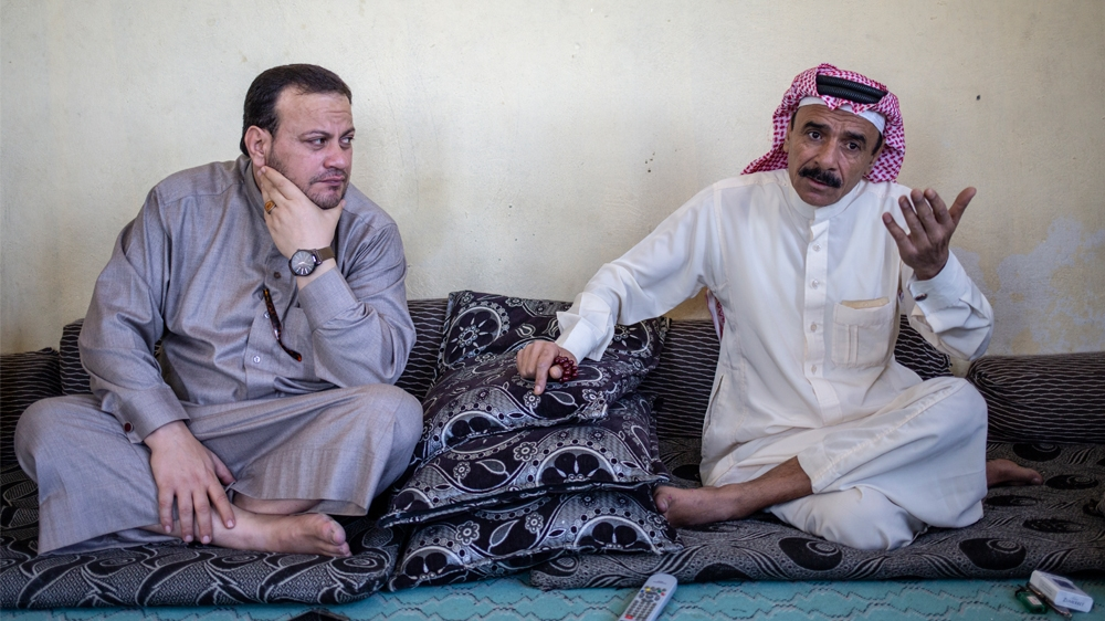 1) Mahmoud Asaad, gestures as he speaks alongside his friend from nearby Raqqa province [Farah Najjar/ Al Jazeera]