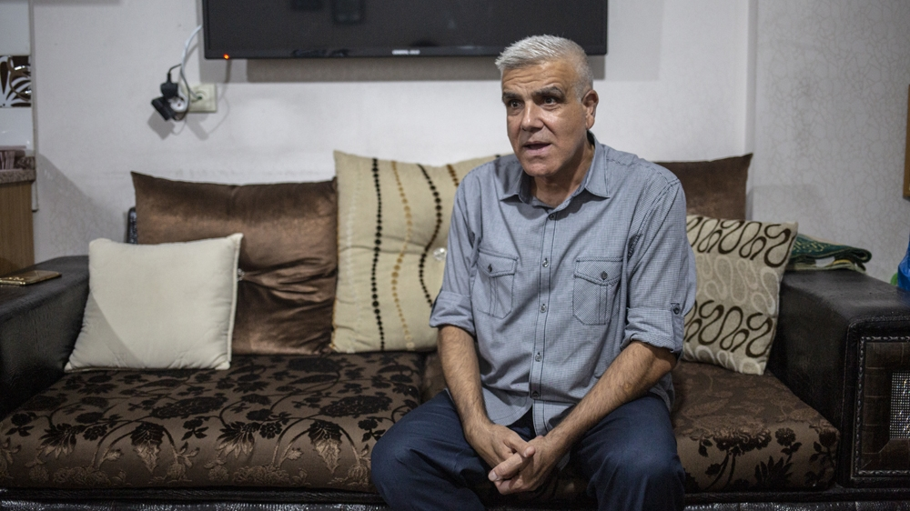 Ibrahim Jaddou speaks as he sits in his living room in Turkey's Sanliurfa
