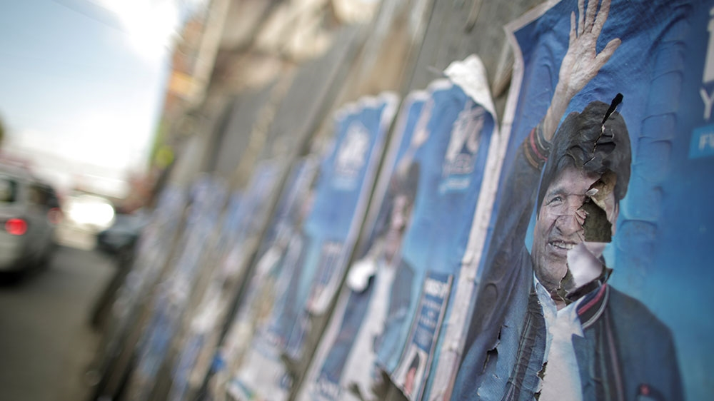 Evo Morales narrowly wins first round in Bolivia's presidential election race