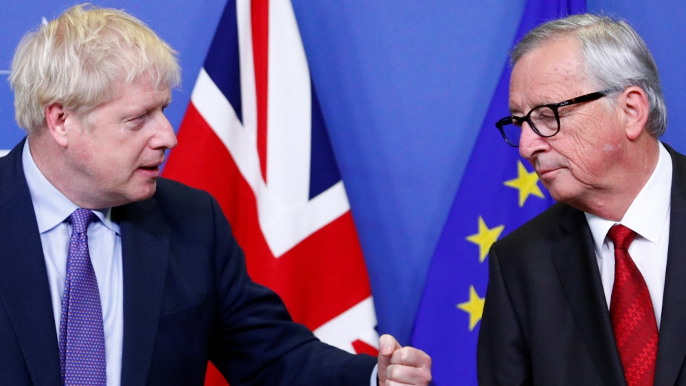 Britain's Prime Minister Boris Johnson gestures next to European Commission President Jean-Claude Juncker