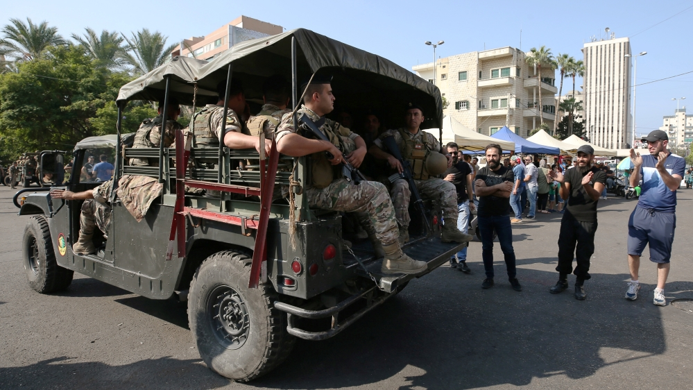Lebanese army soldiers deploy during a protest targeting the government over an economic crisis in the port city of Sidon
