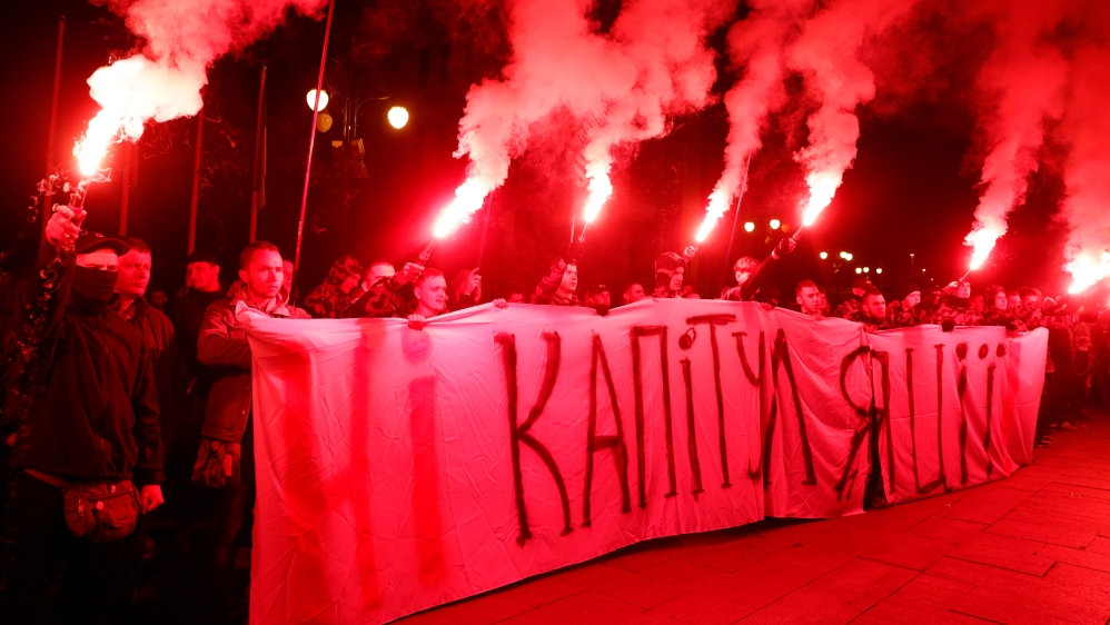 Activists of far-right parties take part in a rally against approval of so-called Steinmeier Formula, in Kiev