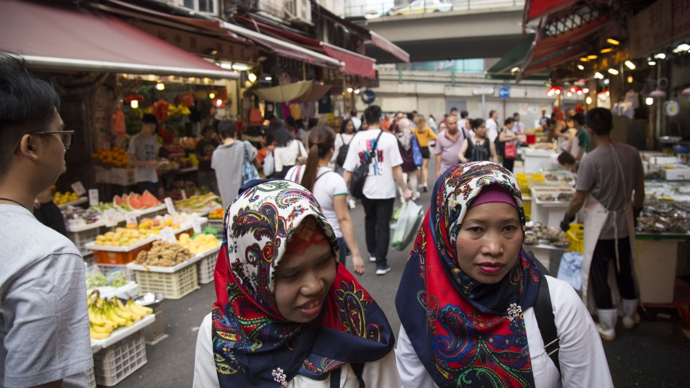 Women walk through a market off Bowrington Road, an area with numerous Indonesian-run businesses, blocks away from protest actions in Wan Chai on Sept. 30, 2019.