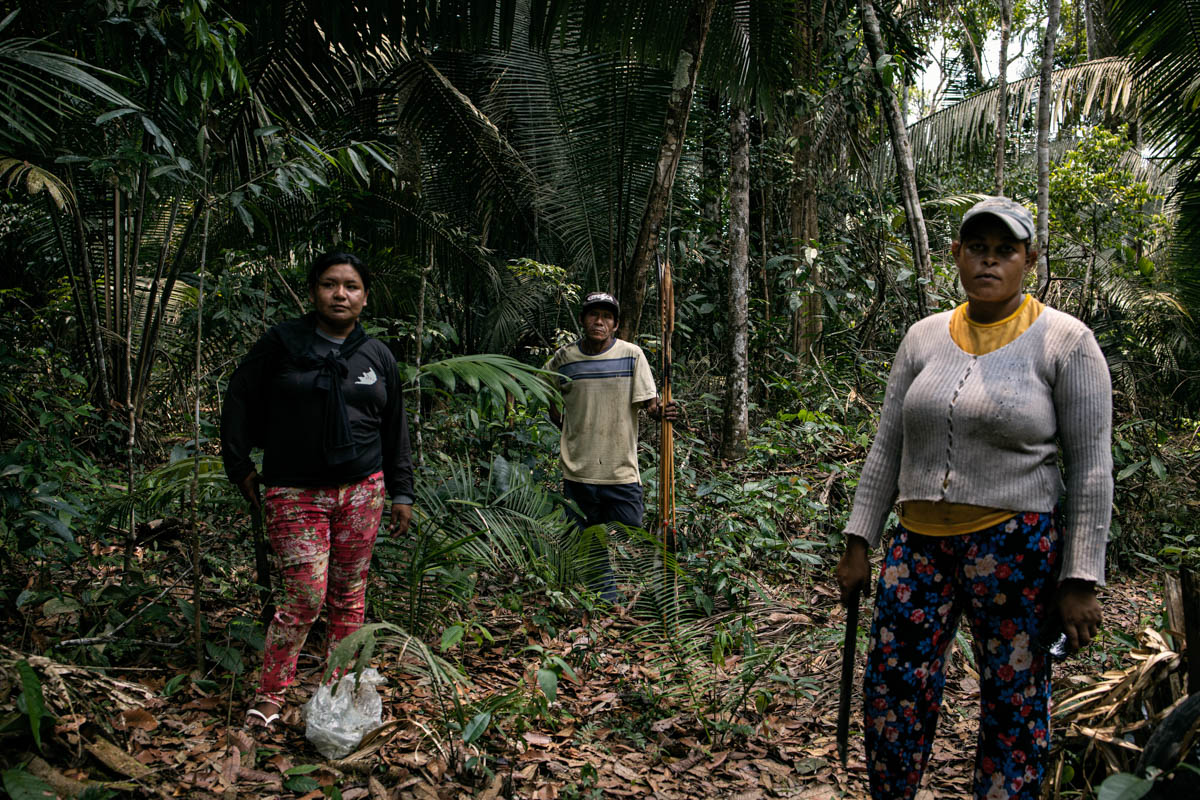 Mayte 32, Purua, 45, and Alessandra, 27, from the Uru-Eu-Wau-Wau indigenous tribe in their Amazon reserve. On September 26, the three took part in a mission in the forest to reach an illegal hut used as a base by land-grabbers who set fire to neighbouring forest.[Fabio Bucciarelli/Al Jazeera]