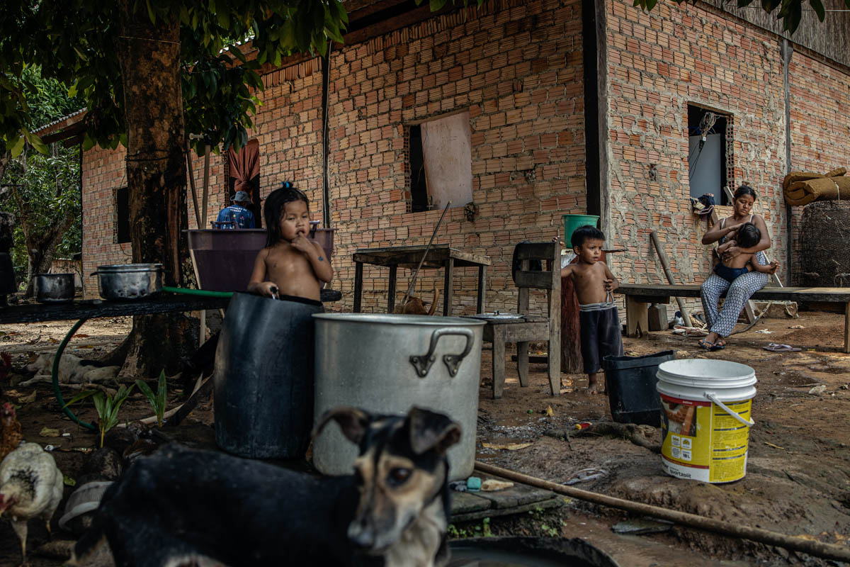 Karitian indigenous tribespeople in the central aldea of their indigenous territory in Rondonia. Private farms surrounding the indigenous territory threaten the Karitians and the forest. [Fabio Bucciarelli/Al Jazeera]