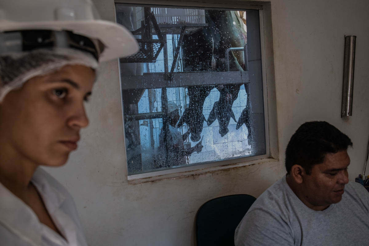 The manager and a veterinarian at the Frigo 10 slaughterhouse in Porto Velho, Rondonia. The beef trade is one of the most profitable activities in the country. [Fabio Bucciarelli/Al Jazeera]