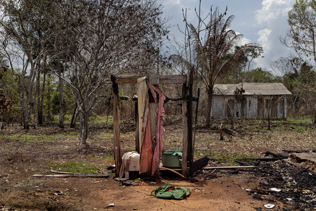 The remains of a house belonging to Jeovaldo in the indigenous territory of the Karitiana tribe, Central Aldea, Rondonia. The house caught fire due to a blaze in a neighbouring forest. Private farms surrounding the indigenous territory threaten the Karitians and the forest. [Fabio Bucciarelli/Al Jazeera]