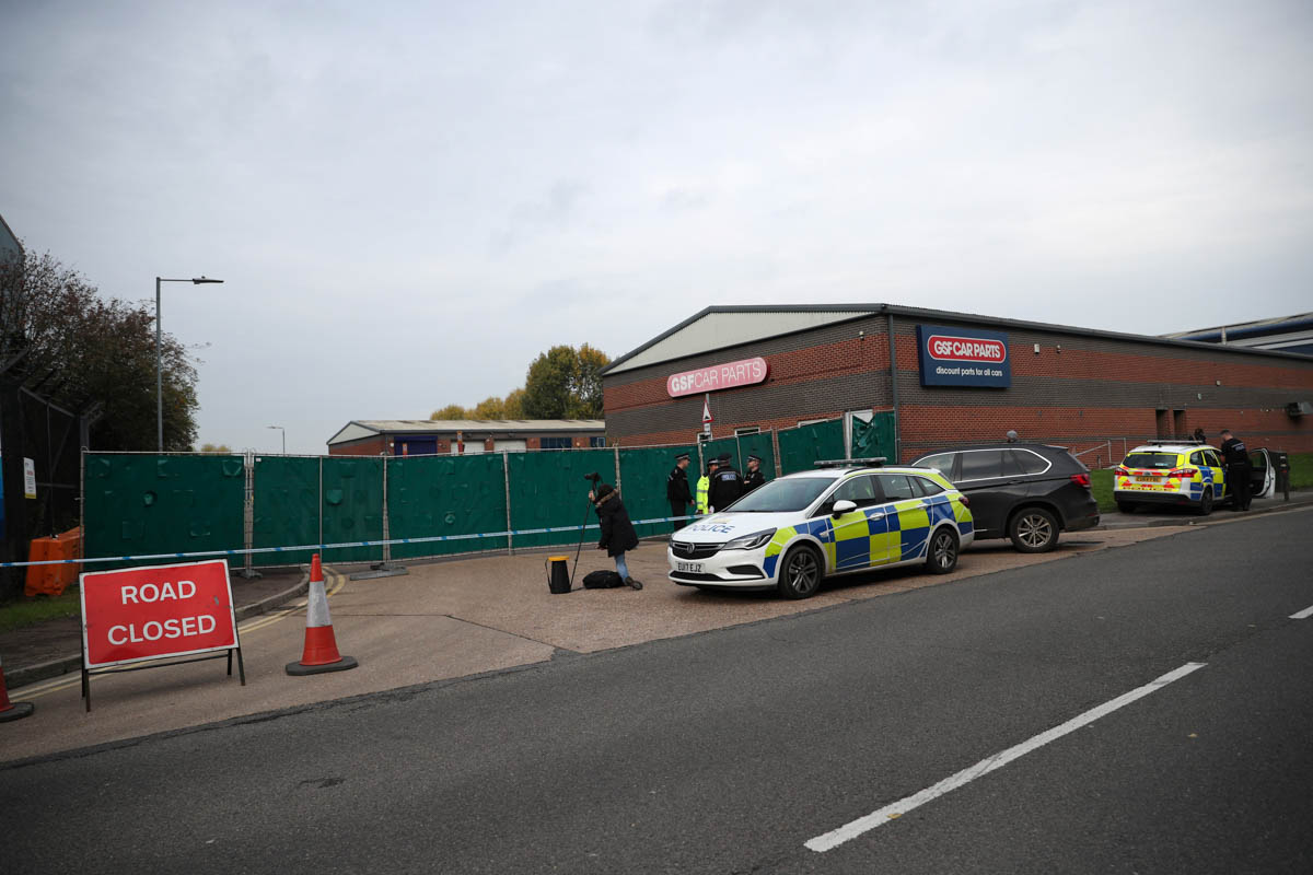 A cordon is placed and access to and from the Waterglade Industrial Park remains closed. [Hannah McKay/Reuters]