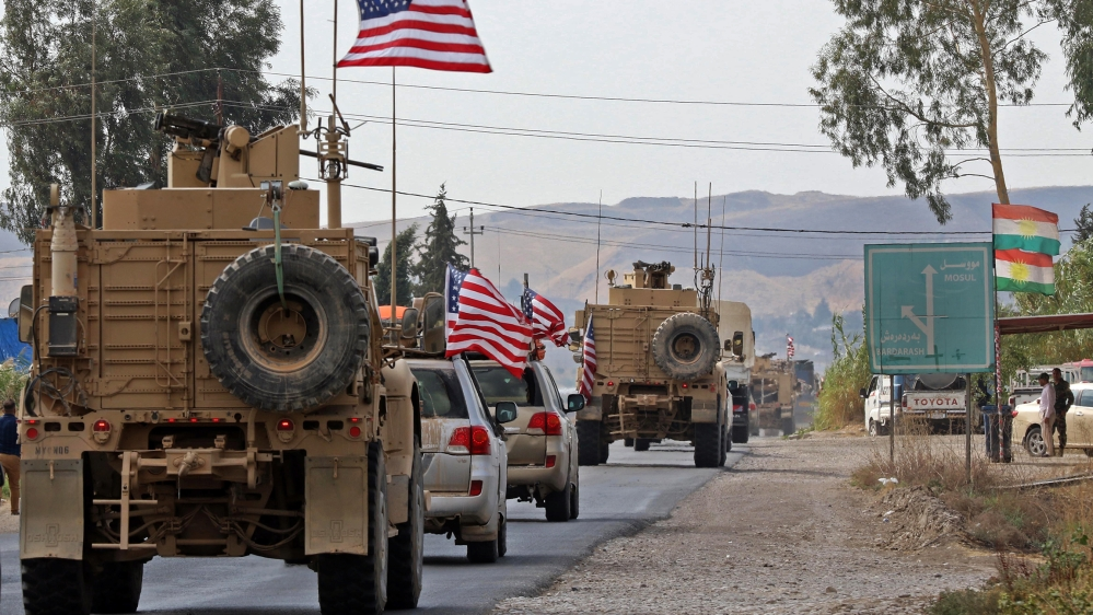 A convoy of US military vehicles arrives near the Iraqi Kurdish town of Bardarash in the Dohuk governorate after withdrawing from northern Syria on October 21, 2019.  SAFIN HAMED / AFP