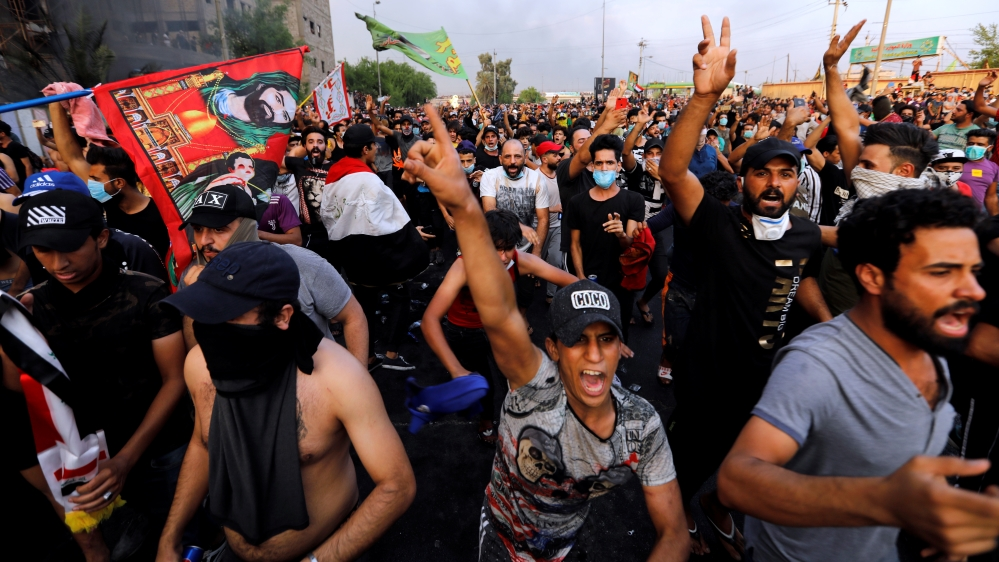 Demonstrators gesture at a protest over unemployment, corruption and poor public services, in Baghdad