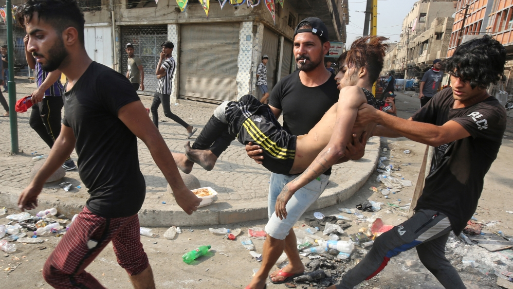 Death toll rises to about 100 in violent protests in Iraq