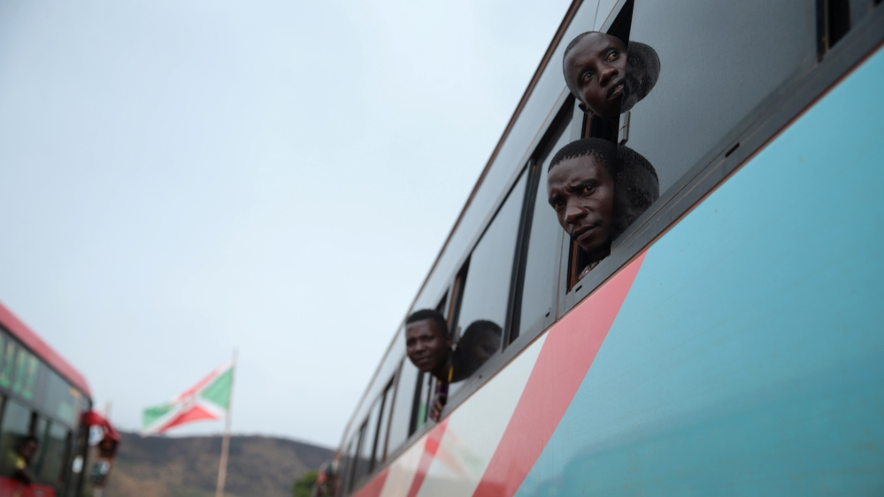 Burundian refugees look out from a bus which transported them from Tanzania to neighbouring Burundi, as part of a repartition program, in Burundi