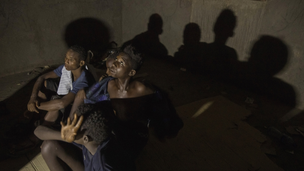 Ethiopian migrant boys ages 13 to 16, who crossed at night from Ethiopian borders, rest in an abandoned one-floor, brick house in Ali Sabeih, Djibouti. Migrants take shelter here until early morning