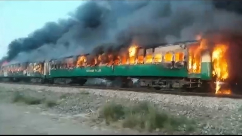 Dozens killed in Pakistani train fire after cooking stoves explode inside carriage