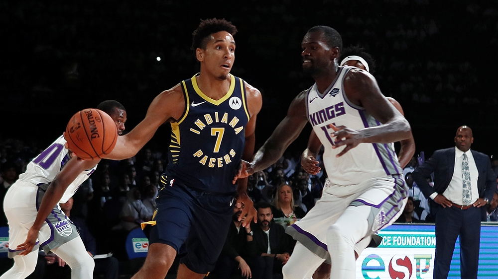 Basketball - NBA Preseason Friendly - Indiana Pacers v Sacramento Kings - NSCI Dome, Mumbai, India - October 4, 2019  Indiana Pacers' Malcolm Brogdon in action with Sacramento Kings' Dewayne Dedmon  R