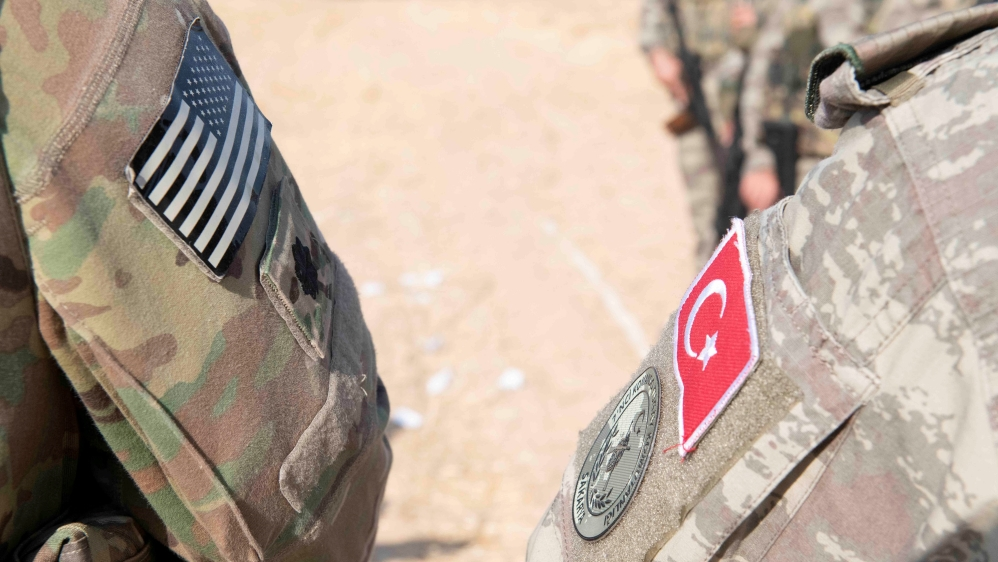 U.S. and Turkish military forces conduct a joint ground patrol inside the security mechanism area in northeast, Syria, October 4, 2019. Picture taken October 4, 2019