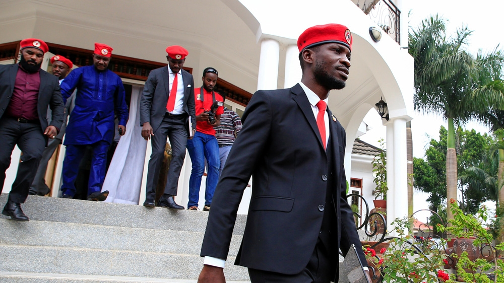 Ugandan pop star-turned-politician escapes arrest on motorbike