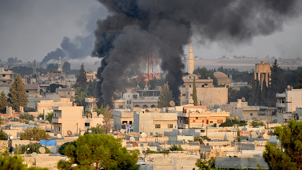 SANLIURFA, TURKEY - OCTOBER 09: A photo taken from Turkey's Sanliurfa province, on October 09, 2019 shows smoke rises at the site of Ras al-Ayn city of Syria as Turkish troops along with the Syrian Na