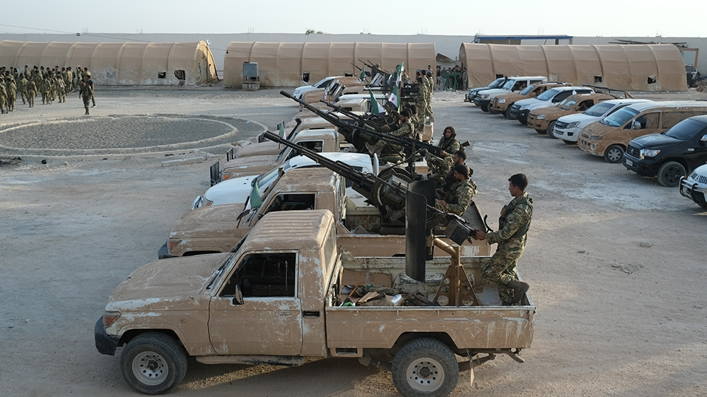 Turkey-backed members of Syrian National Army prepare for moving to Turkey with heavy armed vehicles for an expected military operation by Turkey into Kurdish areas of northern Syria, in Azas near Tur