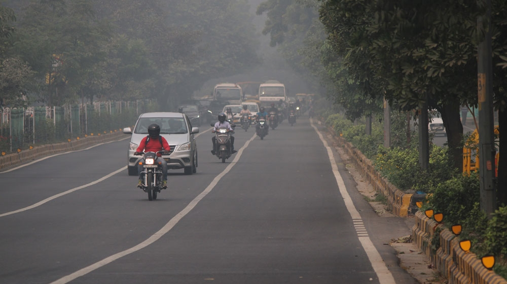 Indian capital banishes half its cars to curb hazardous air pollution