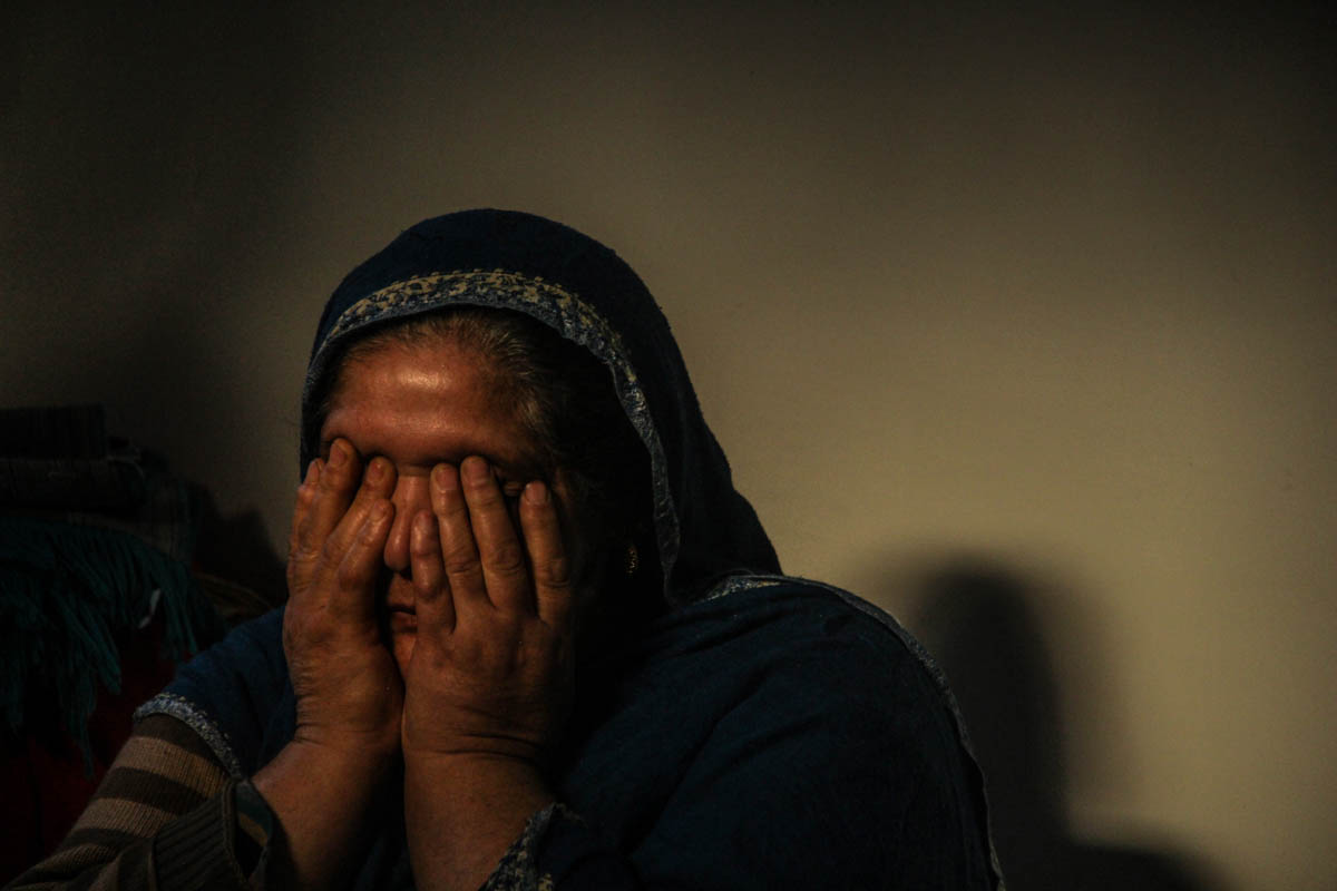 Parveena, mother of Aqib Rafiq Wani, a detained management student from Shopian, said: 'I get flashbacks of the night when my son was taken away by the Indian forces. I am waiting for the moment when he will be returned to me.' Wani was arrested on August 8 in a midnight raid at his house. He has been lodged in a jail outside Kashmir under the stringent Public Safety Act. Indian authorities arrested an estimated 13,000 boys in Jammu and Kashmir since August 5, according to a fact-finding report by a team of five women activists who visited the region recently. [Mukhtar Zahoor/Al Jazeera]