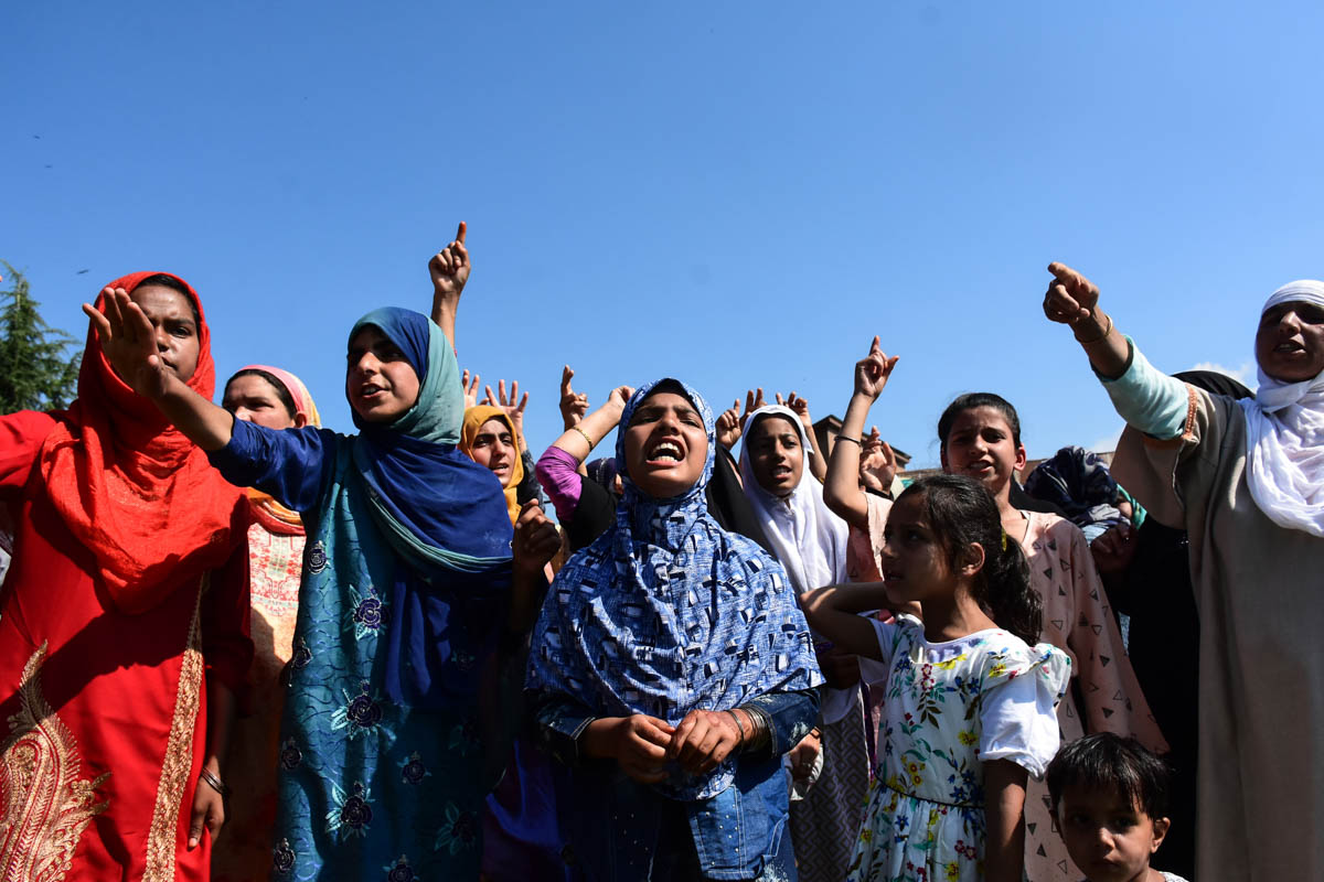 Kashmiri women chanting pro-freedom slogans after Eid al-Adha prayers in Srinagar's Anchar. [Mukhtar Zahoor/Al Jazeera]