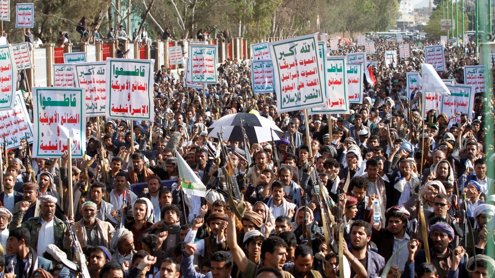 Supporters of the Houthi movement attend a rally to celebrate following claims of military advances by the group near the borders with Saudi Arabia, in Sanaa
