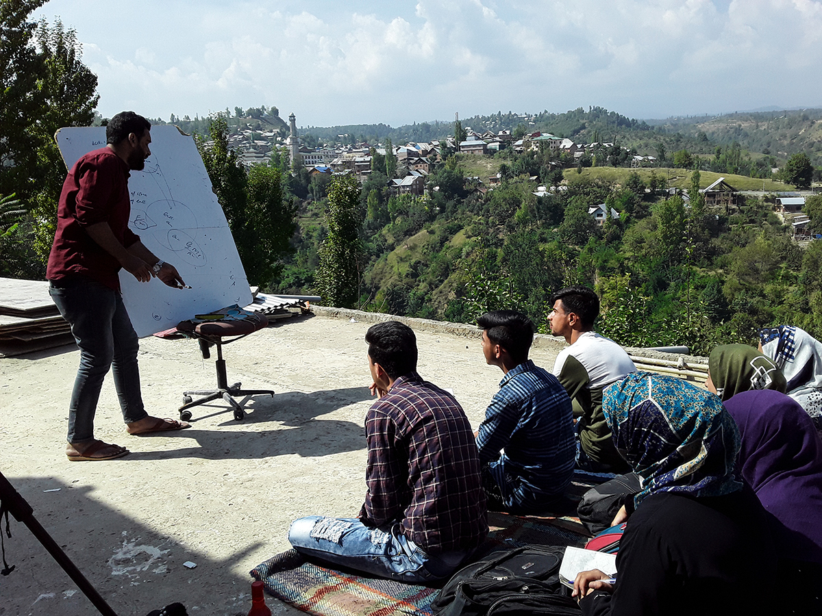 "As education suffered, people in several parts of the Kashmir valley opened free tuition centres to help the students. 'I along with three of my friends requested several parents to send their wards to get education free of cost. It was challenging to persuade the parents that they will be taking the responsibility of the safety of their children,"" said Bilal Ahmad, a teacher from Charar-e-Sharif area. [Mukhtar Zahoor/Al Jazeera]"