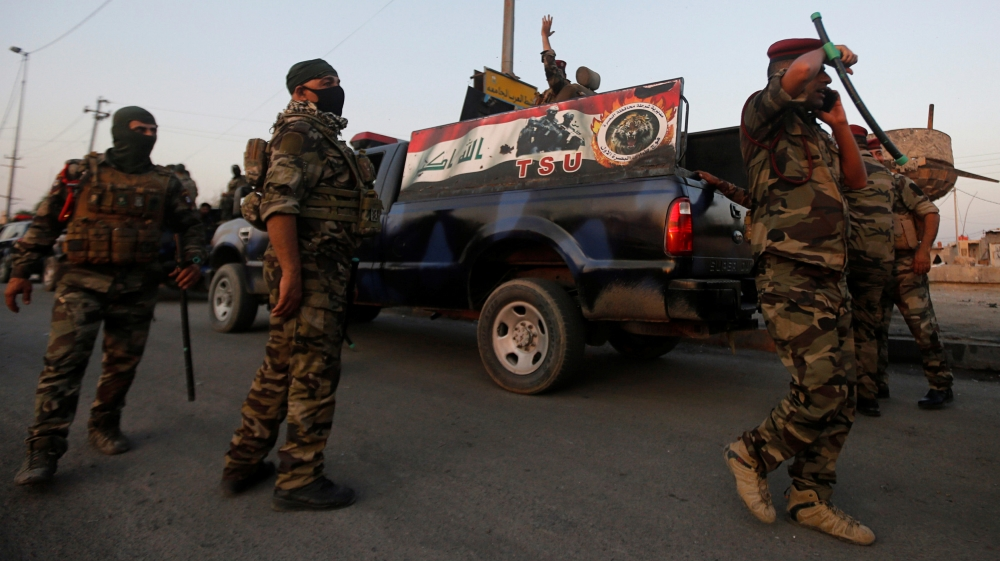Members of Iraqi security forces are seen during the ongoing anti-government protests in Basra
