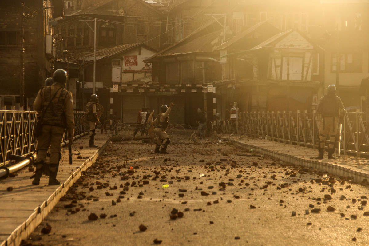 Pelting of stones at downtown Srinagar's Habba Kadal area, which witnessed clashes between young boys and Indian security forces. Stone-pelting is the most common form of resistance in the region as young Kashmiris throw rocks at the forces and shout pro-freedom slogans. [Mukhtar Zahoor/Al Jazeera]