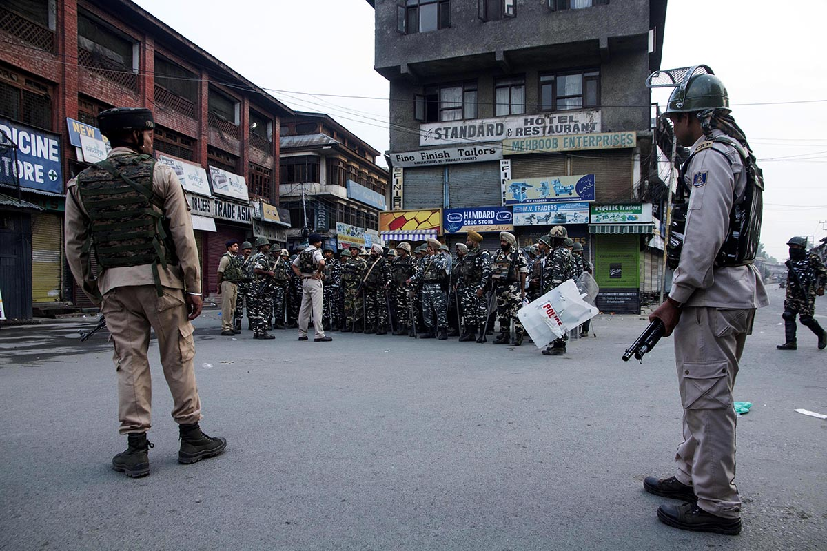 Paramilitary troops being briefed at Srinagar's Lal Chowk area on the morning of August 5, the day the Parliament of India abrogated Article 370. Thousands of troops were sent in anticipation of protests from the Kashmiris against the decision. The disputed region was turned into a fortress with armed troops manning every nook and corner. [Mukhtar Zahoor/Al Jazeera]