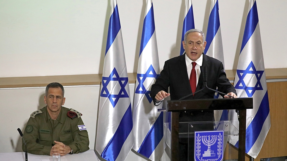 Israeli Prime Minister Benjamin Netanyahu (R) and Chief of Staff of the Israel Defense Forces (IDF) Aviv Kochavi (L) hold a special press conference on the current security situation between Israel a