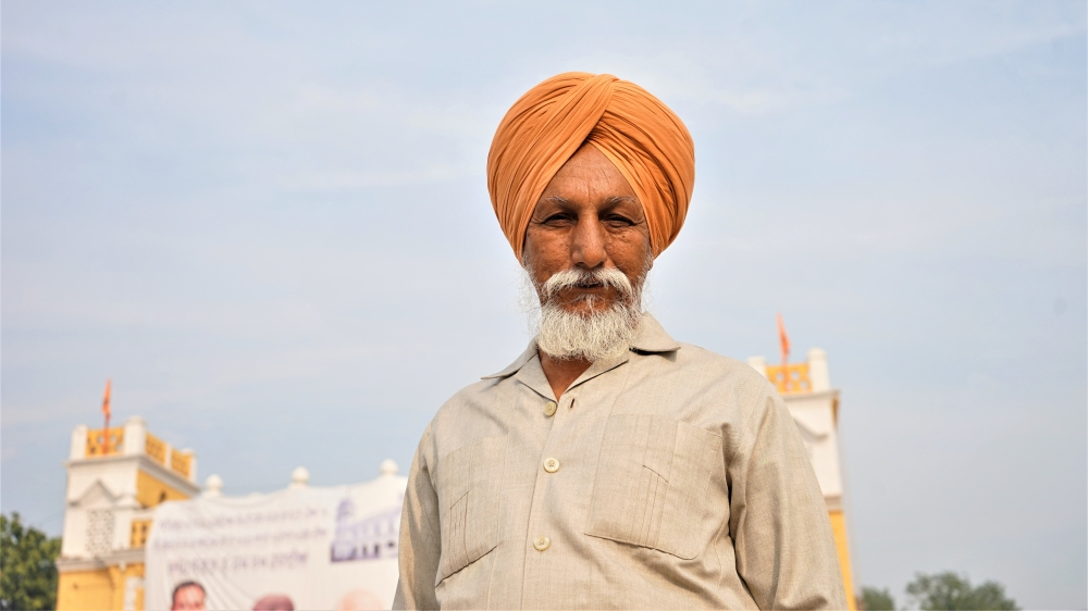 Gurmit Singh, 67, a Sikh from Chandigarh, India poses in Nankana Sahib, Pakistan on the 550th birth anniversary of Guru Nanak, Sikhism's founder