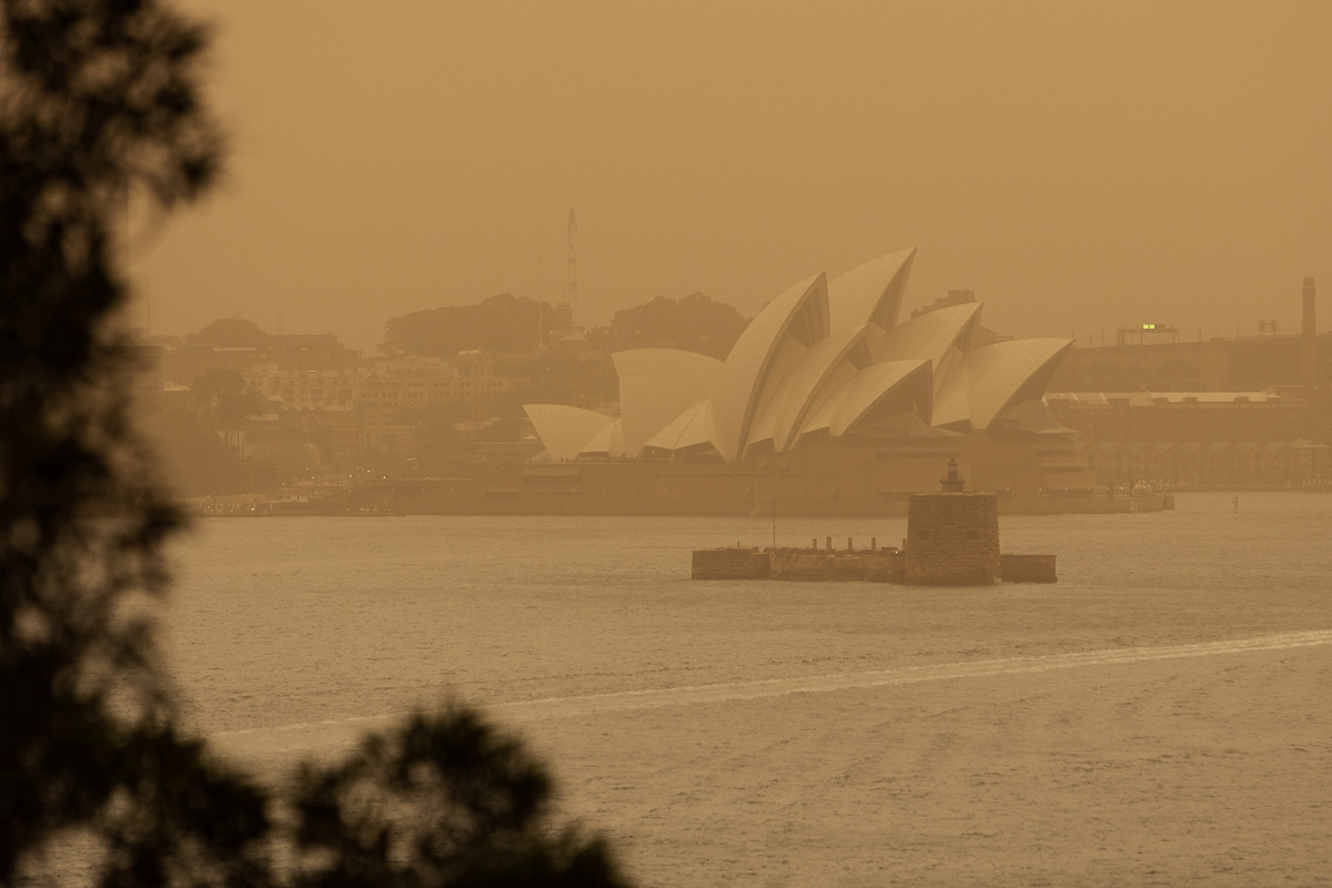 A view of the Sydney Opera House as smoke haze from the bushfires drifts over the city. [Paul Braven/AAP Image via Reuters]