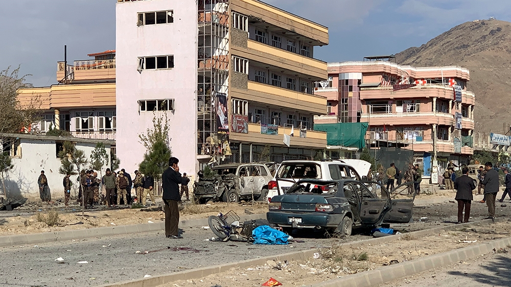 Afghan security personnel gather at the site of an explosion in Kabul, Afghanistan, Wednesday, Nov. 13, 2019. An explosion has rocked the Afghan capital of Kabul as early morning commuters were on the
