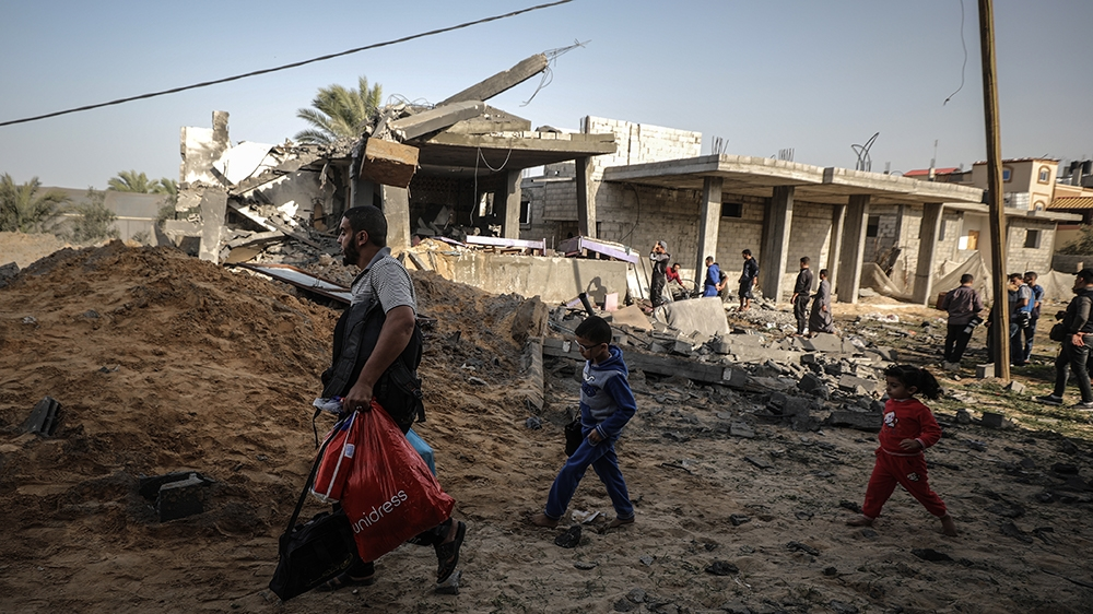 RAFAH, GAZA - NOVEMBER 13: People inspect debris after Israeli airstrikes hit Abu Hadayids' home in Rafah, Gaza as tension rises between Israel and Gaza after commander in the Al-Quds Brigades, the ar