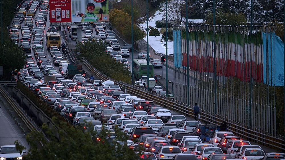 A highway is blocked by vehicles as protests block the roads following fuel price increase in Tehran, Iran, 16 November 2019.  Media reported that people protested on highways after the government inc