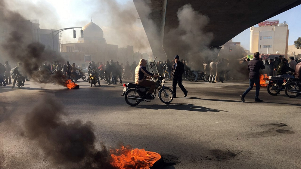 This is to amend image epa08002047 issued on 16 November 2019, correcting CITY to Isfahan (not: Tehran). The revised caption reads:   Iranian protesters block a highway following fuel price increase i
