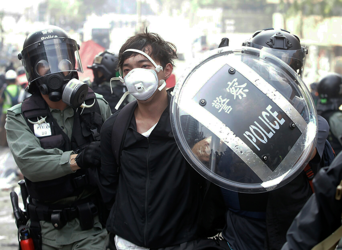 Protesters have accused the police of using excessive force. [Achmad Ibrahim/AP Photo]