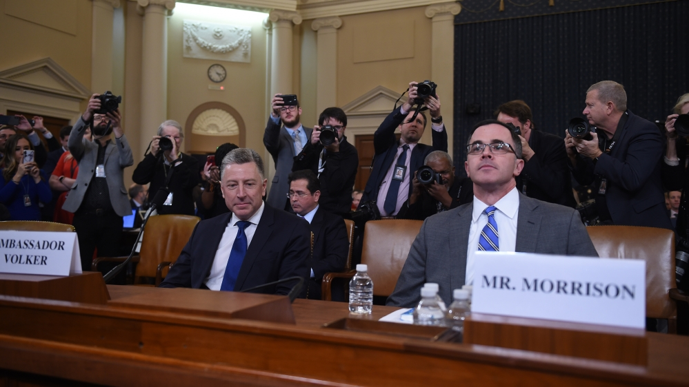 Former US Special Envoy for Ukraine, Kurt Volker (L), and Tim Morrison, the top Russia and Europe adviser on President Donald Trump's National Security Council, prepare to testify during the House Int