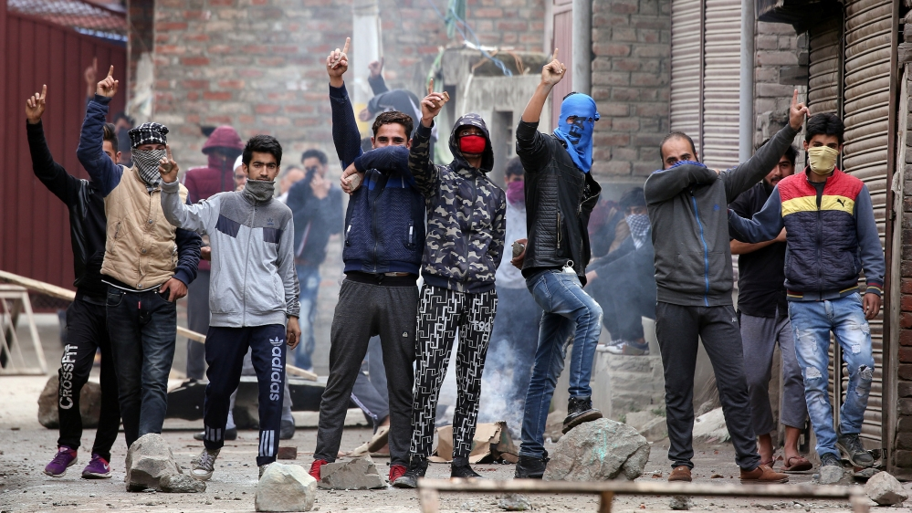 Kashmiri demonstrators react during clashes with Indian police during a protest against the killing of Zakir Rashid Bhat also known as Zakir Musa, the leader of an al Qaeda affiliated militant group i