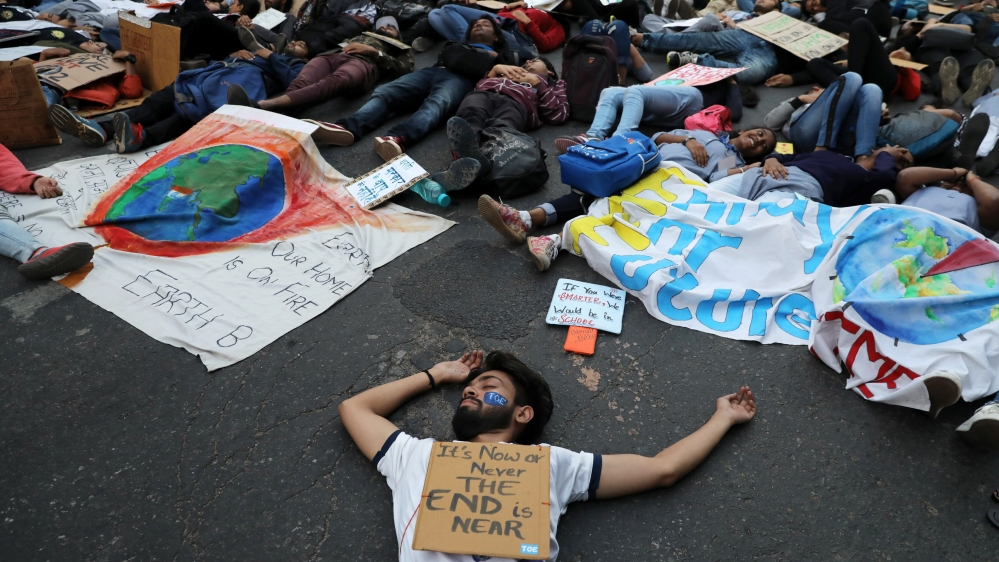 People stage a die-in during a Global Climate Strike rally calling for urgent measures to combat climate change, in New Delhi